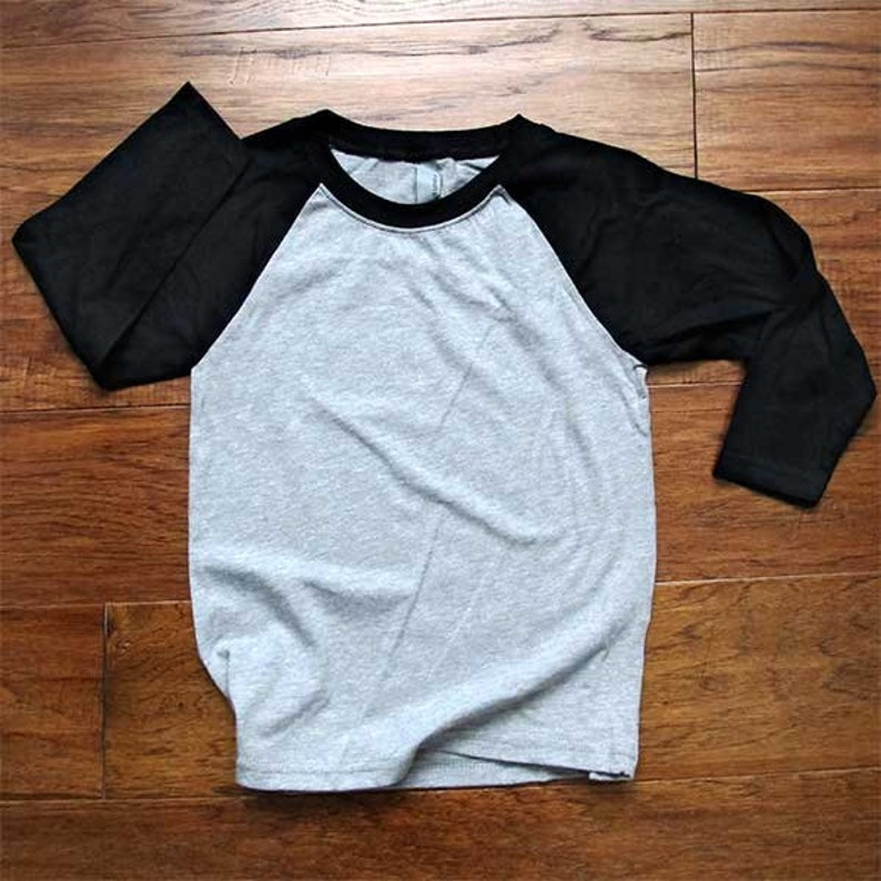 This is for an Existing design you choose for me to print on Youth Raglan 34-Sleeve Baseball T-Shirt