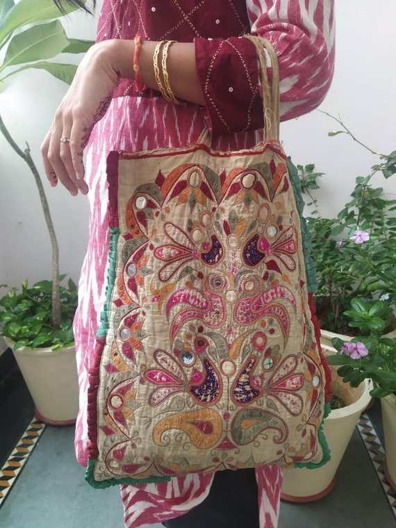 Vintage theli bag with handembroidery and figures,