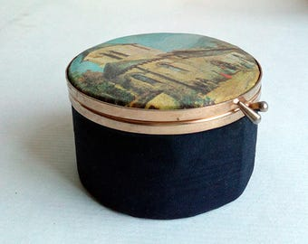 Small Cylindrical Jewelry Box with Painting on the Top.