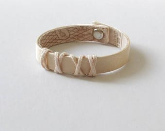 En Pointe (patent pending), reversible, upcycled, recycled, leather, satin, bracelet from used pointe shoes. Made in NYC