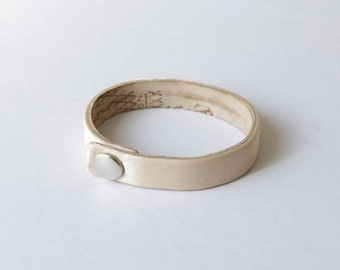Demi Pointe (patent pending), reversible, upcycled, recycled, leather and satin bracelet from used pointe shoes. Made in NYC