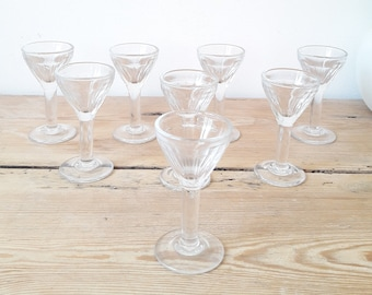 Old liquor glasses in preseated glass/foot glasses bistro style/8 pieces 1950