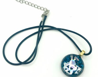 Alice in Wonderland swirling resin design with character inclusion in a Silver Bezel with key charm on Keychain
