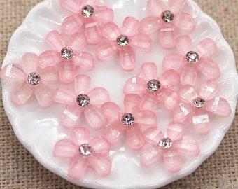 Pink resin flower cabochon, rhinestone centre
