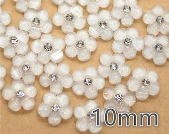 White pearl effect flower embellishments, 10mm