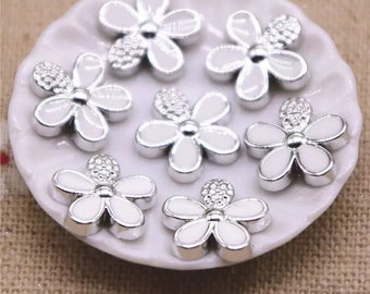 White and silver resin flower cabochons