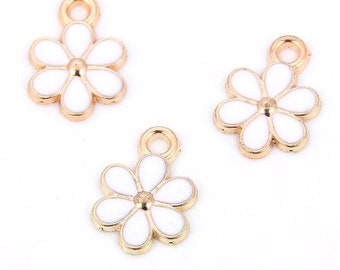 Enamel flower, gold tone charms x 3