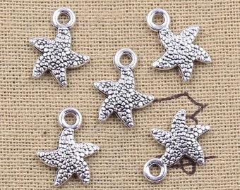 Silver starfish charm x 4