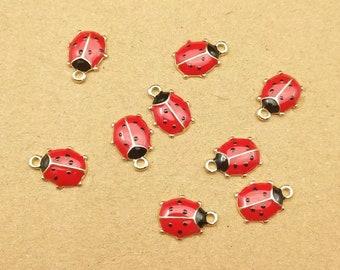 Ladybird enamel charms x 2