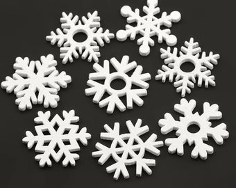 White wooden snowflake decorations, wooden embellishments