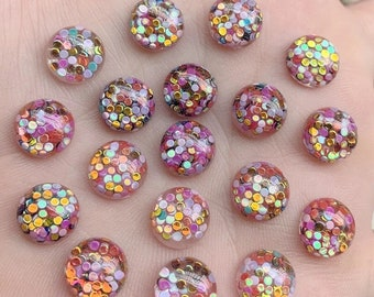 Round glitter filled cabochons, 10mm resin