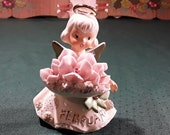 Lefton February Angel with Spaghetti Trim, Holding a Bunch of Violets, Gold Painted Wing Tips, Halo and Accents. Cute Hand Paintted Face. 4 quot