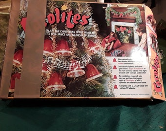 Vintage Carolites Musical Christmas Lights. Plays 11 Christmas Carols. Set of 9 Bells in Original Box. Fireplace, Mantle or Stairway decor.