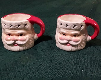 """Mid Century Ceramic Santa Shot Glass, Espresso Cups. Hand Painted with Stocking Cap Handle. 1970's Japan. 1 3/4"""" Tall. National Potteries co"""