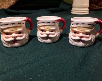 "3 Vintage Ceramic Santa Mugs, Stocking Cap Handle. Hand Painted Red, White and Flesh Tones. 1970's Japan. Detailed Jolly Santa, 2 3/4"" Tall"