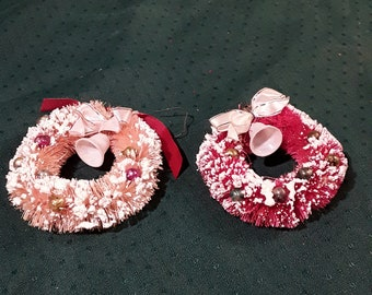 """2 Vintage Bottle Brush Xmas Flocked Wreaths, period ribbon Bows, Blown Mercury Glass Beads, Plastic Bells. 1 Red, 1 Pink. 1950's, 3"""" wide."""
