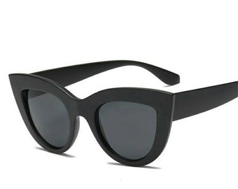 Wide matte black cateye sunglasses