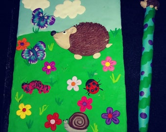 Polymer clay hedgehog noteboil and pen
