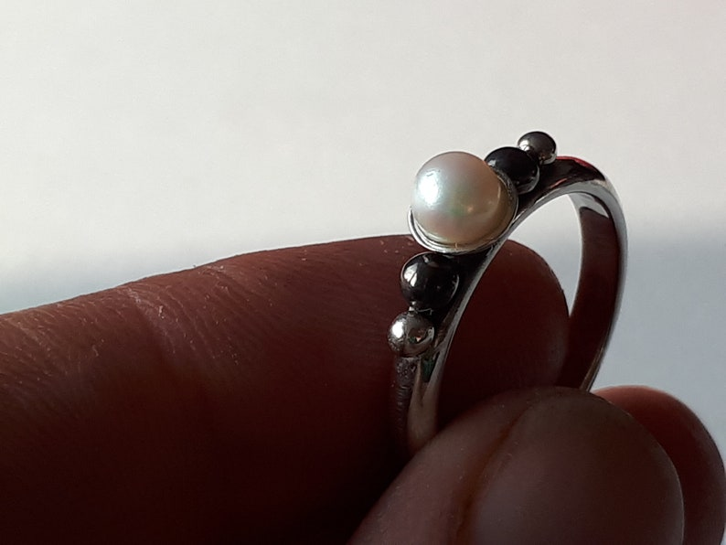 Silver handmade unique ring with pearl.