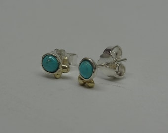 Fine silver with turquoise earrings and golden details.