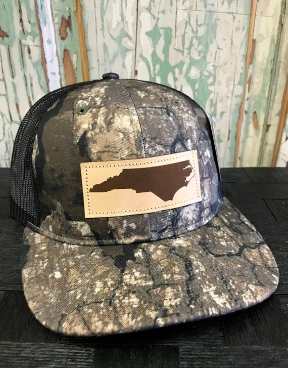 7b1b0055 North Carolina Leather Patch NC Trucker Hat Realtree Timber | Etsy