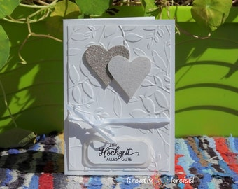 Wedding card embossed leaves, glitter hearts