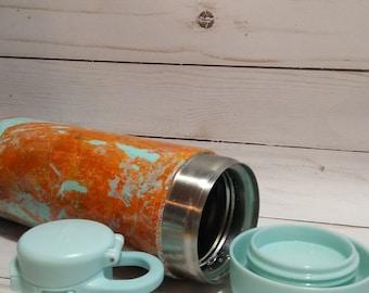 Orange sea foam green locking water bottle