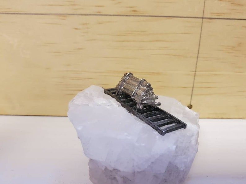 Pewter Railcar on top of Calcite Crystal
