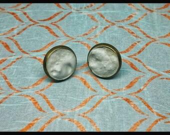 Concrete moon earrings.