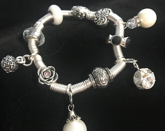 Beautiful coiled silver plated charm bracelet