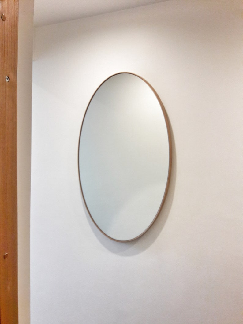 Elliptical Mirror with Wood Frame image 0
