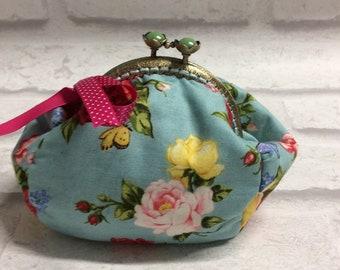 Floral clasp purse