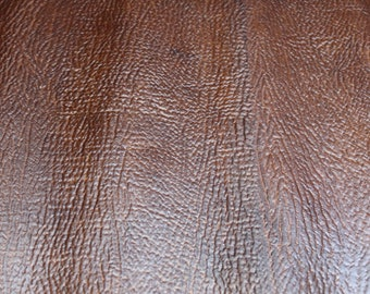 Brown shark embossed pullup cowhide leather 2.5-3oz. Perfect for handbags, shoes and leather crafts