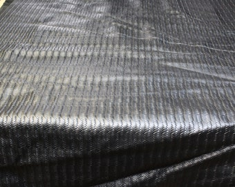 Black woven embossed cowhide leather 2.5-3oz. Perfect for handbags, shoes and leather crafts
