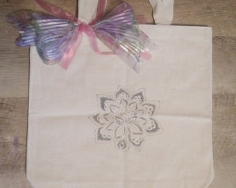 Hand stenciled tote with pink and purple ribbon embellishment