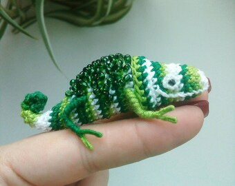 Green chameleon with beads