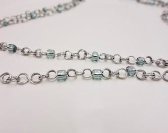 Light Necklace. Steel Chain and Smoky Blue Glass Beads.