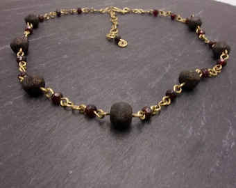 Brass Necklace with Black Czech Glass Beads and Faceted Garnet.