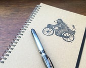 BEAR ON BIKE A5 notebook - lined, hand stamped & spiral bound- by Catherine Redgate