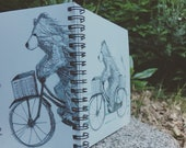 Bear on Bike spiral-bound square notebook - plain inside- by Catherine Redgate
