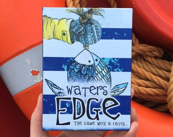 WATERS EDGE the game with a catch! Illustrated card game Catherine Redgate coastal sea fishing fish coast board lighthouse gift ocean whale