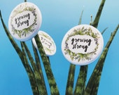 GROWING STRONG  32mm button badge - pin - by Catherine Redgate - botanical leaf motivational positive message mental health