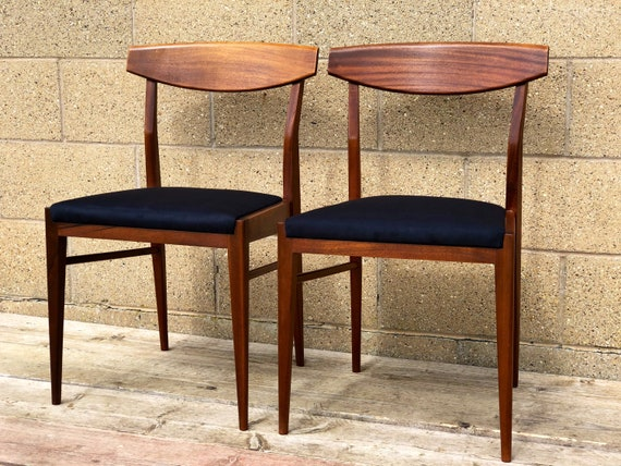 Two MCM Danish Style Teak Chairs with Black Suede Seat