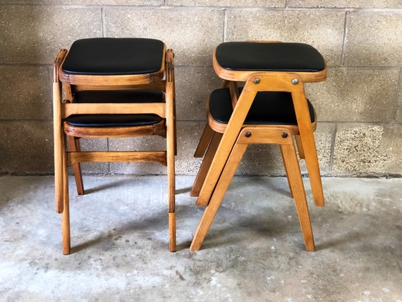 A Pair of Vintage Reupholstered Stacking Ben Stools