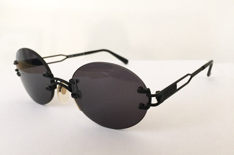59116910664 Moschino Sunglasses 90s vintage black rimless lens round oval