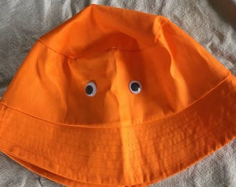 Orange bucket hat with googley eyes inspired by Big Lez