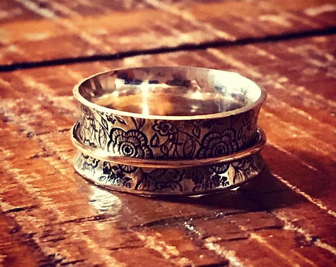The BRKN designed Floral spinner ring