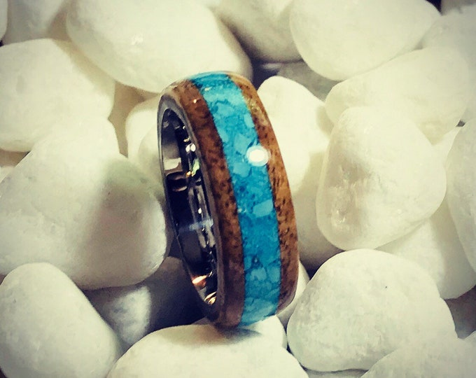 Hawaiian Koa wood ring with a turquoise inlay and a stainless steel core