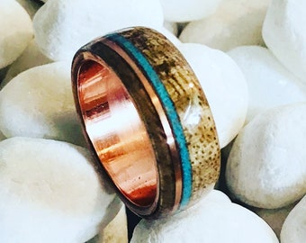Hawaiian Koa wood ring with crushed Turquoise and copper Inlays and a copper band.