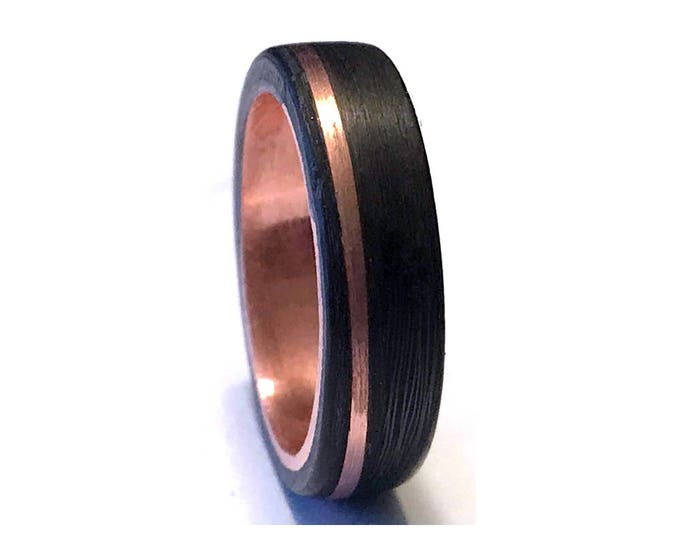 Carbon fiber and copper core ring with a offset copper Inlay